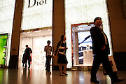 A Chinese family leaves a Dior shop in a popular shopping centre in Hong Kong. During the Chinese New year millions of Chinese travel to Hong Kong in order to experience a new way of traveling which includes shopping.