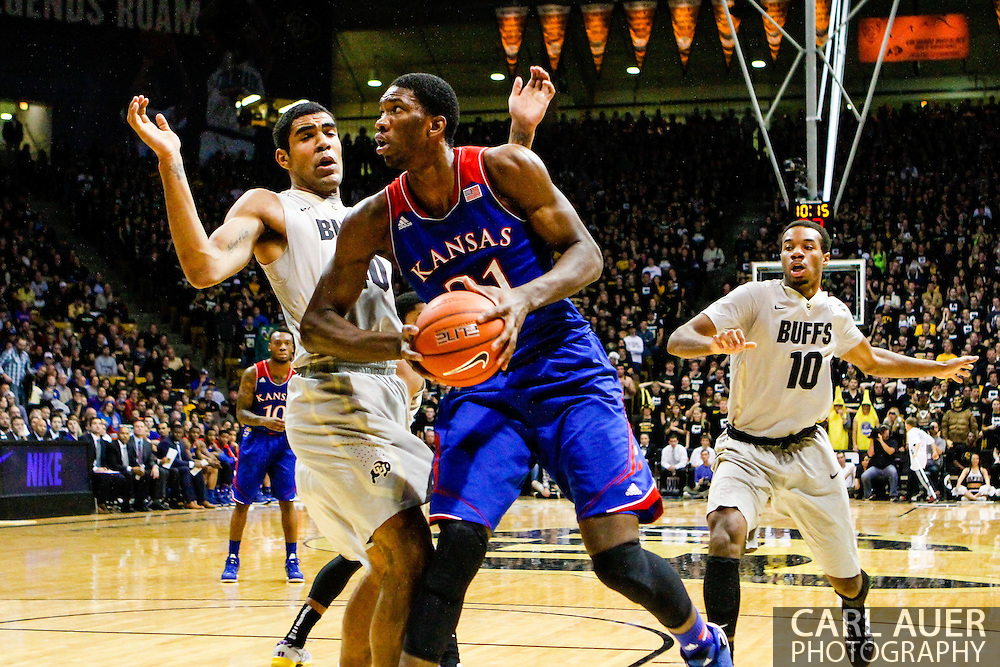 December 7th, 2013:  Kansas Jayhawks freshman center Joel Embiid (21) tries to get past Colorado Buffaloes sophomore forward Josh Scott (40) in the first half of the NCAA Basketball game between the Kansas Jayhawks and the University of Colorado Buffaloes at the Coors Events Center in Boulder, Colorado