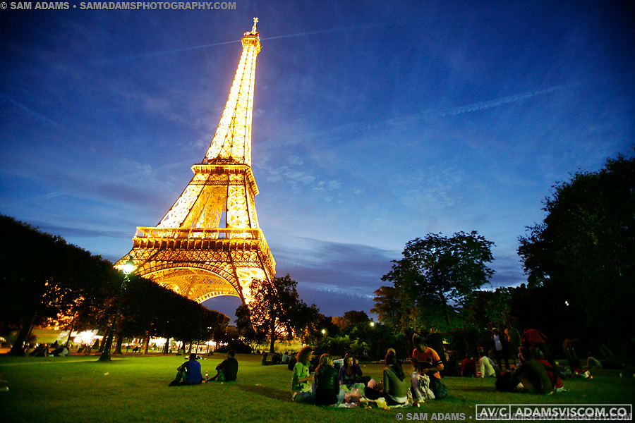 People gather in the Champs du Mars Park in front of the Eiffel Tower in Paris, France on June 18, 2008.