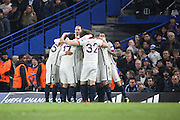 PSG players celebrating Adrien Rabiot's opening goal during the Champions League match between Chelsea and Paris Saint-Germain at Stamford Bridge, London, England on 9 March 2016. Photo by Matthew Redman.