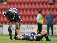 Photo: Lee Earle.<br /> Swindon v Southend. Coca Cola League 1.<br /> 10/09/2005. Southend's Mitchell Cole checks Luke Guttridge after he goes down in pain.