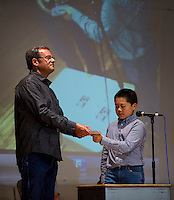 """Jose DeMatos is asked to """"pick a card"""" from Jet Wang and he performs a card trick on stage during Holy Trinity's talent show Tuesday afternoon.  (Karen Bobotas/for the Laconia Daily Sun)"""