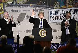 April 4, 2017 - Washington, District of Columbia, United States of America - United States President Donald Trump makes remarks at the 2017 North America's Building Trades Unions National Legislative Conference at the Washington Hilton in Washington, DC, April 4, 2017..Credit: Olivier Douliery / Pool via CNP (Credit Image: © Olivier Douliery/CNP via ZUMA Wire)