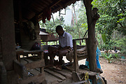 Khom, 14, puts his socks on before leaving on a 30 minute walk simply to get to the edge of the forest. After that he must sit on a motorbike for a further 15 minutes just to get to school. Because of the distance and difficulty for the parents the children often miss school.<br /> <br /> The Maniq of Trang province differ slightly as they were the first to give up nomadic life and became permanently settled in their own remote forest village.<br /> <br /> Evidence suggests that the Maniq, a Negrito tribe of hunters and gatherers, have inhabited the Malay Peninsula for around 25,000 years. Today a population of approximately 350 maniq remain, marooned on a forest covered mountain range in Southern Thailand. Whilst some have left their traditional life forming small villages, the majority still live the way they have for millennia, moving around the forest following food sources. <br /> <br /> Quiet and reclusive they are little known even in Thailand itself but due to rapid deforestation they are finding it harder to survive on the forest alone and are slowly being forced to move to its peripheries closer to Thai communities.