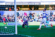 Leeds United forward Patrick Bamford (9) is fouled by Queens Park Rangers goalkeeper Liam Kelly (32) during the EFL Sky Bet Championship match between Queens Park Rangers and Leeds United at the Kiyan Prince Foundation Stadium, London, England on 18 January 2020.
