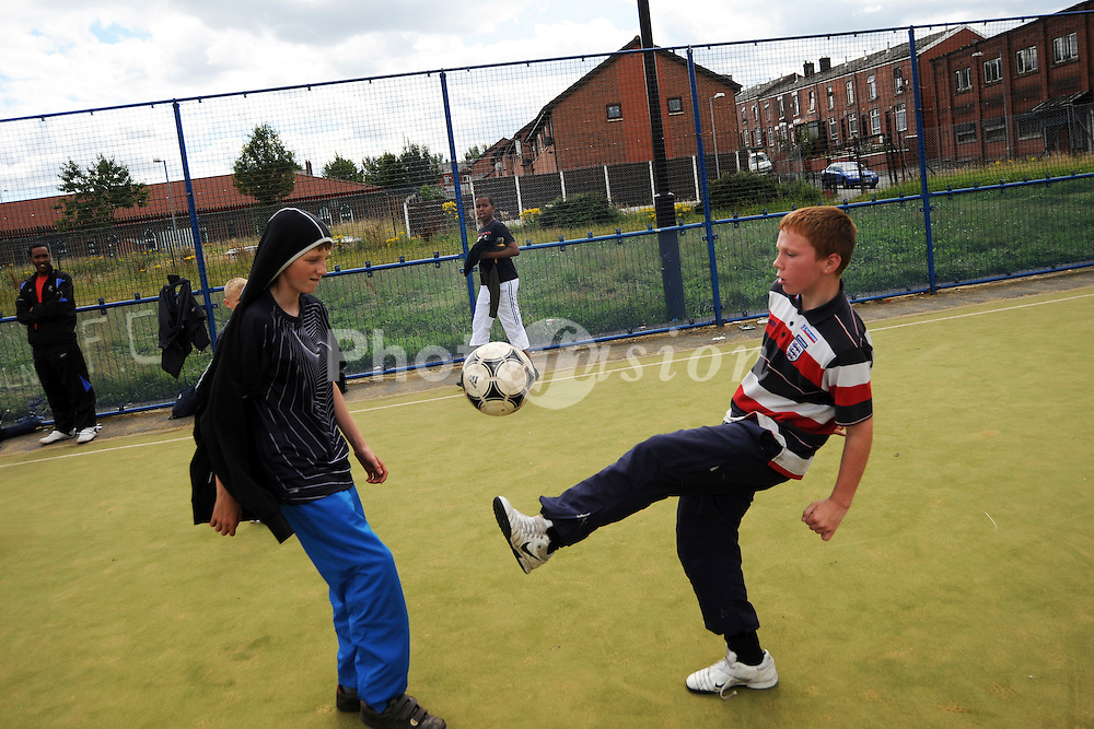 Football training session with the NBSCA Bolton Wonderers for local children,The Communities R Us project seeks to build a better understanding of the ways in which long-term residents and newer refugee communities can build positive relationships at neig