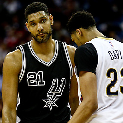 Mar 3, 2016; New Orleans, LA, USA; San Antonio Spurs center Tim Duncan (21) and New Orleans Pelicans forward Anthony Davis (23) during the fourth quarter of a game at the Smoothie King Center. The Spurs defeated the Pelicans 94-86. Mandatory Credit: Derick E. Hingle-USA TODAY Sports