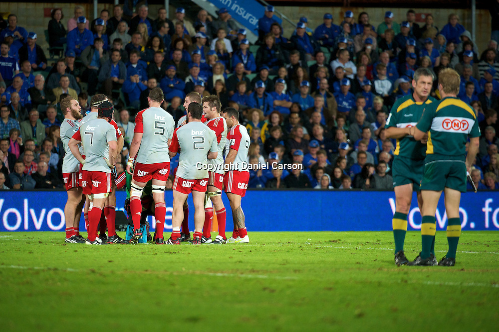 The Crusaders enter a team huddle while the umpires conferr. Western Force v Canterbury Crusaders. Super 15 Rugby Match. Perth, Western Australia, nib Stadium. Saturday 30th April 2011. Photo: Daniel Carson|PHOTOSPORT