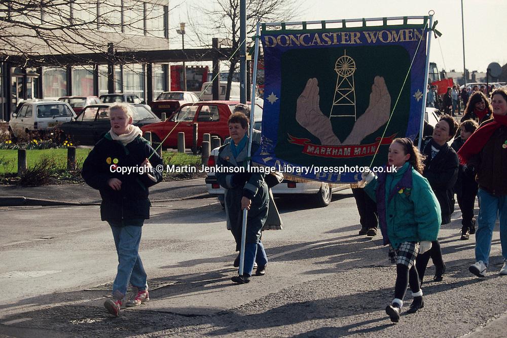 Doncaster WAPC banner on the NUM 'No Pit Closures' march . Doncaster. 27/02/1993.
