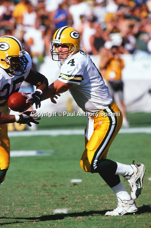 Green Bay Packers quarterback Brett Favre (4) hands off the ball on a running play during the NFL football game against the San Diego Chargers on Oct. 24, 1999 in San Diego. The Packers won the game 31-3. (©Paul Anthony Spinelli)
