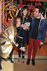 Left to right,  JENNIFER SAUNDERS as her TV character Edina Monsoon, ALEXA CHUNG and NICK GRIMSHAW at a party to celebrate the switching on of the Christmas Lights at the Stella McCartney store, Bruton Street, London on 29th November 2011.