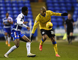 Reading's Nathaniel Chalobah and Wigan Athletic's Leon Clarke in action during the Sky Bet Championship match at Madejski Stadium on 17 February 2015 in Reading, England - Photo mandatory by-line: Paul Knight/JMP - Mobile: 07966 386802 - 17/02/2015 - SPORT - Football - Reading - Madejski Stadium - Reading v Wigan Athletic - Sky Bet Championship