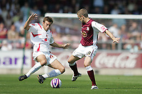Photo: Lee Earle. <br /> Northampton Town v Swindon Town. Coca Cola Championship. 11/08/2007. <br /> Swindon's Michael Pook (L) battles with Ryan Gilligan.