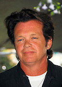 NEW YORK - JUNE 11: Farm Aid Co-founder John Mellencamp poses at a stall in the Farmer's Market before the press conference announcing plans for Farm Aid in Union Square Park on June 11, 2007 in New York City.
