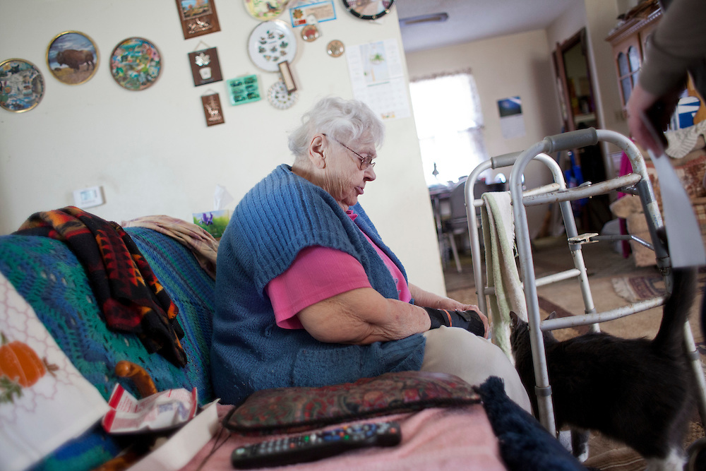 Louise Niedermayer talks to her cat, Snoopy, on Thursday, November 19, 2015 in Cedar Rapids, Iowa. Niedermayer lives alone and receives a Meals on Wheels delivery daily from one of the volunteers at Horizons, A Family Service Alliance. (Rebecca F. Miller/Freelance for The Gazette)