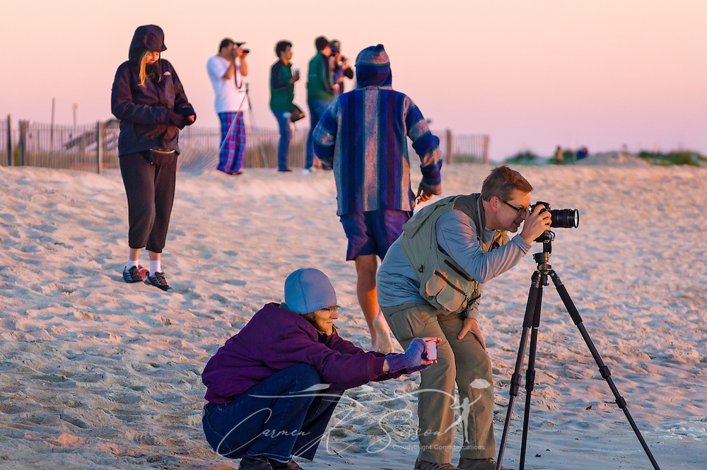 Tourists take photos of the sunrise at the St. Johns County Ocean Pier, March 21, 2016, in St. Augustine, Florida. (Photo by Carmen K. Sisson/Cloudybright)