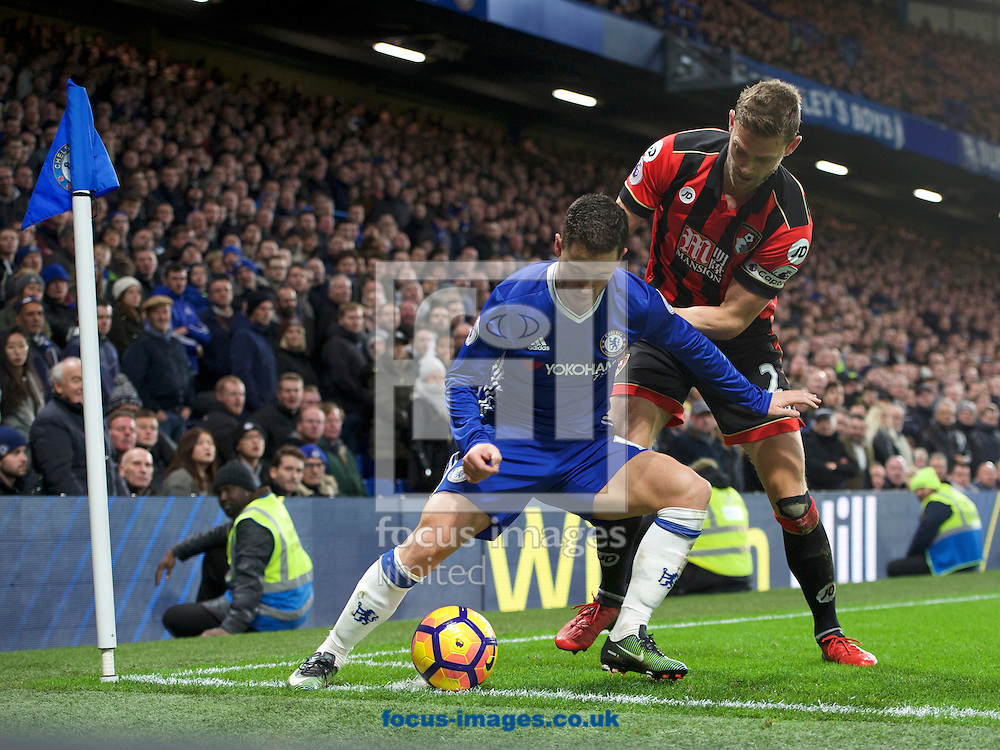 Eden Hazard of Chelsea shields the ball from Simon Francis of Bournemouth during the Premier League match at Stamford Bridge, London<br /> Picture by Alan Stanford/Focus Images Ltd +44 7915 056117<br /> 26/12/2016