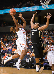 Virginia guard Ariana Moorer (15) shoots over Colorado guard Bianca Smith (2).  The #16 ranked Virginia Cavaliers women's basketball team defeated the Colorado Buffaloes 77-43 at the John Paul Jones Arena on the Grounds of the University of Virginia in Charlottesville, VA on November 24, 2008.