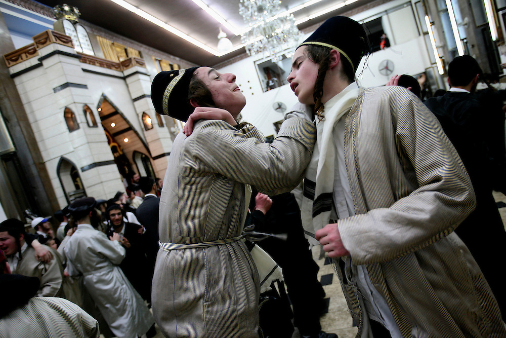Ultra-Orthodox Jewish men dance at a yeshiva, a rabbinical seminary, during Purim celebrations in Jerusalem, Wednesday, March 11, 2009. The festival of Purim commemorates the rescue of Jews from genocide in ancient Persia. Many revelers will often consume alcohol to intoxication. Photo by Olivier Fitoussi /FLASH90