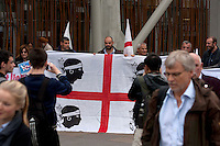 Members of Italian political supporters protesting holding a flag outside of the Scottish Parliament.<br /> Members of different political ideal gather in the scottish parliament due what Today 18th September is the Scottish Referendum. Pako Mera/Universal News And Sport (Europe) 18/09/2014