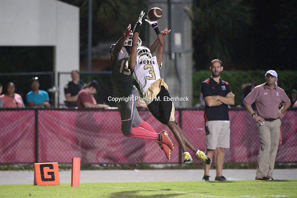 Ocoee's Kendall Bohler (3) attempts to intercept a pass intended for Edgewater receiver Jeremiah Chambers (13) in the end zone during the second half of a high school football game Monday, Oct. 9, 2017, in Orlando, Fla. The play was ruled an incompletion and Edgewater won 44-29. (Photo by Phelan M. Ebenhack)