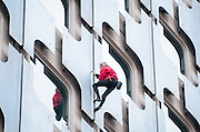 ALAIN ROBERT ' THE FRENCH SPIDERMAN ' TAKES ACTION AGAINST MOROSIT ... AND FOR HUMOUR climbs ARIANE TOWER deploying a banner <br /> ©Exclusivepix Media