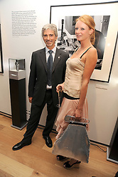 DAMON HILL and OLIVIA INGE at the TAG Heuer British Formula 1 Party at the Mall Galleries, London on 15th September 2008.