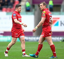 Scarlets' Steff Evans with team-mate Hadleigh Parkes<br /> <br /> Photographer Simon King/Replay Images<br /> <br /> Guinness PRO14 Round 19 - Scarlets v Glasgow Warriors - Saturday 7th April 2018 - Parc Y Scarlets - Llanelli<br /> <br /> World Copyright © Replay Images . All rights reserved. info@replayimages.co.uk - http://replayimages.co.uk
