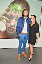 Left to right, Artist MIKE DARGAS and VALERIA COSTA MARTINEZ at a private view of woks by German artist Mike Dargas held at the Opera Gallery, 134 New Bond Street, London on 5th July 2016.