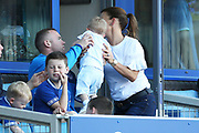 Pass the baby - Everton striker Wayne Rooney (10) and wife Coleen   during the Premier League match between Everton and Southampton at Goodison Park, Liverpool, England on 5 May 2018. Picture by Craig Galloway.