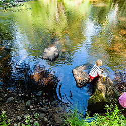 Young siblings play in the Eightmile River in Lyme, Connecticut.  The Nature Conservancy's Pleasant Valley Preserve.  Connecticut River tributary.