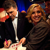 ORLANDO, FL -- September 22, 2011 -- Republican presidential candidate Gov. Rick Perry signs autgraphs during the Florida P5 Faith and Freedom Coalition Kick-Off at the Rosen Centre Hotel in Orlando, Fla., on Thursday, September 22, 2011.  Nine Republican presidential candidates congregated for a Fox News / Google Debate.   (Chip Litherland for The New York Times)