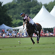 Kris Kampsen, K.I.G. shoots a penalty during the White Birch Vs K.I.G Polo match in the Butler Handicap Tournament match at the Greenwich Polo Club. White Birch won the game 11-8. Greenwich Polo Club,  Greenwich, Connecticut, USA. 12th July 2015. Photo Tim Clayton