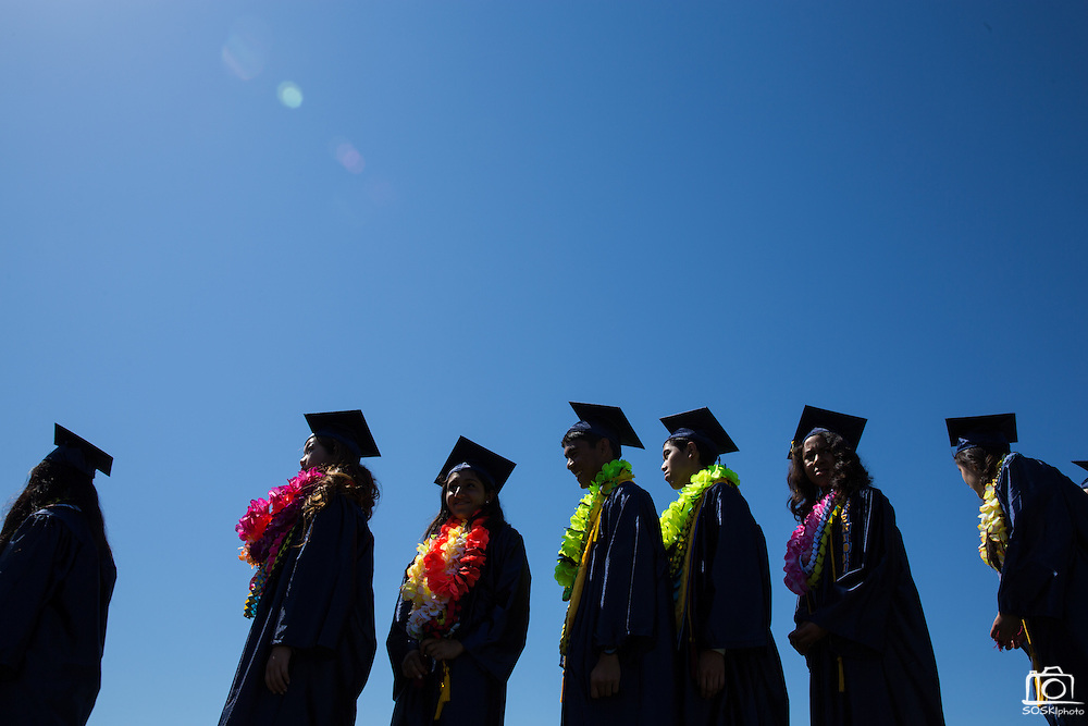 Graduates wait for their names to be call and to receive their diplomas during the graduation ceremony at Milpitas High School in Milpitas, California, on June 6, 2015. (Stan Olszewski/SOSKIphoto)