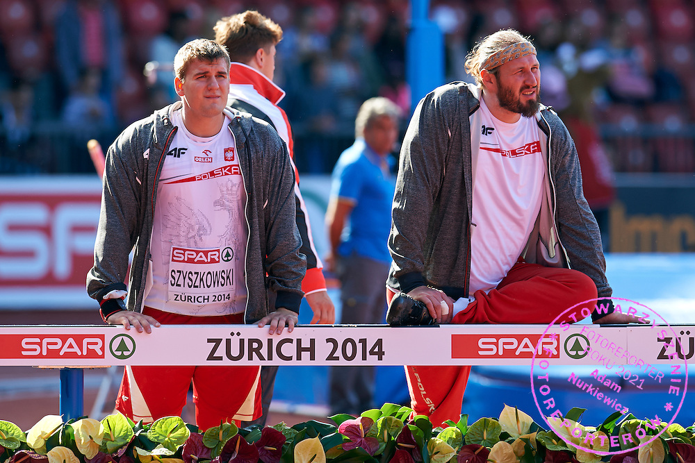 (L) Jakub Szyszkowski and (R) Tomasz Majewski both of Poland compete in men's shot put qualification during the First Day of the European Athletics Championships Zurich 2014 at Letzigrund Stadium in Zurich, Switzerland.<br /> <br /> Switzerland, Zurich, August 12, 2014<br /> <br /> Picture also available in RAW (NEF) or TIFF format on special request.<br /> <br /> For editorial use only. Any commercial or promotional use requires permission.<br /> <br /> Photo by &copy; Adam Nurkiewicz / Mediasport