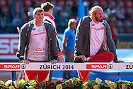 (L) Jakub Szyszkowski and (R) Tomasz Majewski both of Poland compete in men's shot put qualification during the First Day of the European Athletics Championships Zurich 2014 at Letzigrund Stadium in Zurich, Switzerland.<br /> <br /> Switzerland, Zurich, August 12, 2014<br /> <br /> Picture also available in RAW (NEF) or TIFF format on special request.<br /> <br /> For editorial use only. Any commercial or promotional use requires permission.<br /> <br /> Photo by © Adam Nurkiewicz / Mediasport