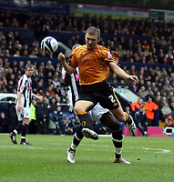 Photo: Mark Stephenson/Sportsbeat Images.<br /> West Bromwich Albion v Wolverhampton Wanderers. Coca Cola Championship. 25/11/2007.Wolve's Darren Ward gets the better of Ishmael Miller