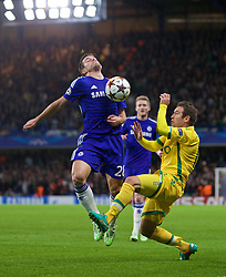 LONDON, ENGLAND - Wednesday, December 10, 2014: Chelsea's Cesar Azpilicueta in action against Sporting Clube de Portugal during the final UEFA Champions League Group G match at Stamford Bridge. (Pic by David Rawcliffe/Propaganda)