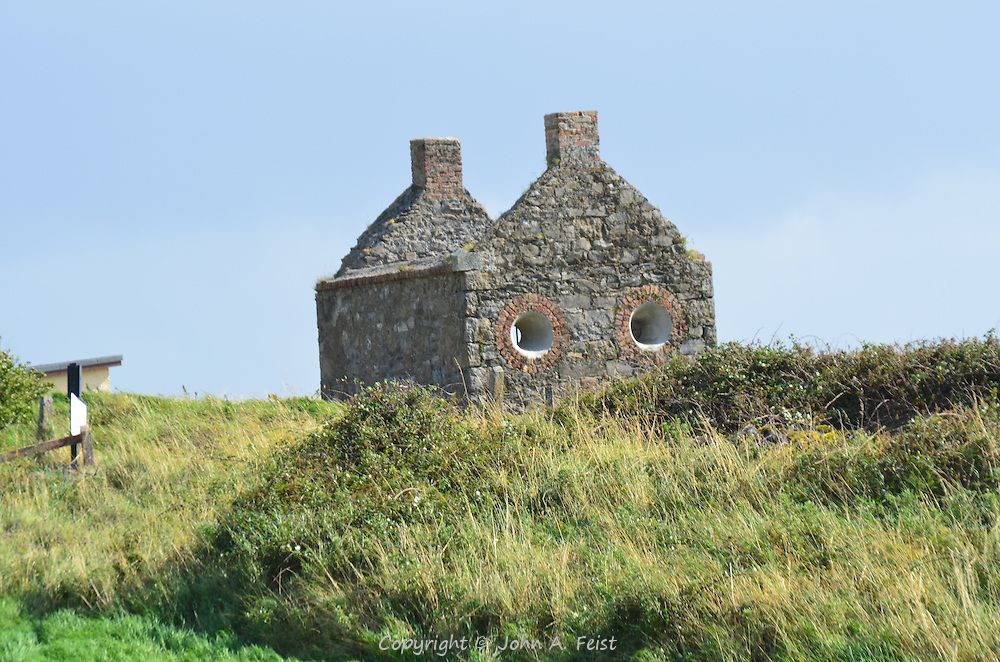An abandoned house outside of Sligo, County Sligo, Ireland.  The configuration of the house and windows gives the impression that it has a face.