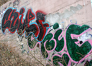 Urban Artwork, Grafitti, on a pink retaining wall in Urban Atlanta.
