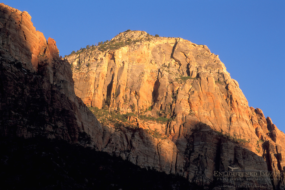 Sunset on sandstone rock cliffs along the Zion - Mt. Carmel Highway, Zion National Park, Uath