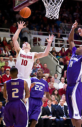 February 13, 2010; Stanford, CA, USA;  Stanford Cardinal guard Drew Shiller (10) shoots over Washington Huskies guard Isaiah Thomas (2) during the first half at Maples Pavilion.  Washington defeated Stanford 78-61.