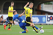 AFC Wimbledon Cody McDonald (10) tackling Burton Albion Kyle McFadzean (6) during the Pre-Season Friendly match between AFC Wimbledon and Burton Albion at the Cherry Red Records Stadium, Kingston, England on 21 July 2017. Photo by Matthew Redman.