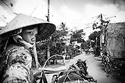 Tearing through a village along the Mekong Delta with a lady of few words and her flower decored horse, Ho Chi Minh City, Vietnam.  Photo by Stan Olszewski/SOSKIphoto