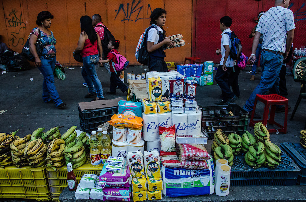 CARACAS, VENEZUELA - JANUARY 14, 2016: Shoppers come to the black market in Petare slum on the outskirts of Caracas to buy hard-to-find products such as soap, shampoo, corn flour, rice, coffee, cooking oil and diapers. All of these items are regulated by government price controls in supermarkets and pharmacies, often times at prices lower than they cost to produce or import -- which leads to shortages. In Petare, vendors illegally re-sell the items at exponentially higher prices, taking advantage of the high demand of hard-to-find products.  PHOTO: Meridith Kohut