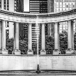 Chicago Wrigley Square Millennium Monument panorama photo. Millennium Monument is a peristyle monument in Millennium Park with a fountain and greek style columns. On the front it displays the names of the founders of Millenium Park. Panorama photo ratio is 1:3.