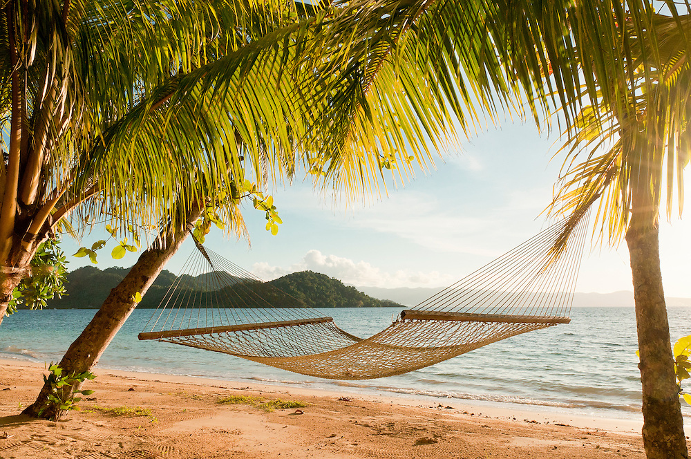 Hammock on beach at Matangi Private Island Resort, Fiji.