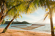Hammock on beach at Matangi Private Island Resort, Fiji.