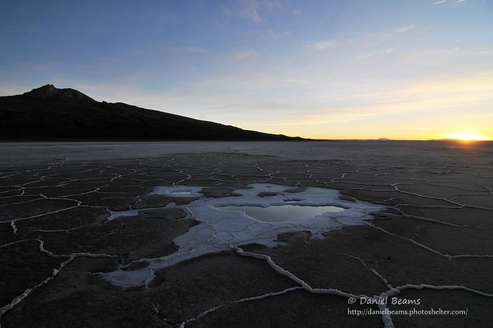 Ojo de sal (salt eye) on the Salar de Uyuni, Bolivia