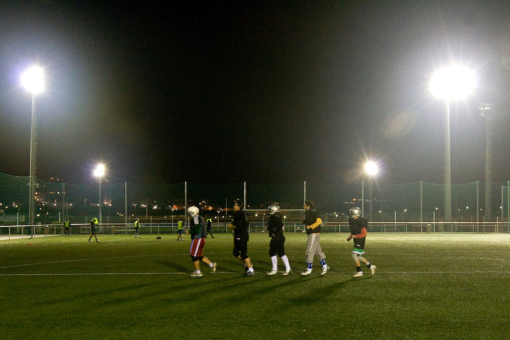(A Coruña, Spain - November 17, 2009) - Under the light of the Tower of Hercules, the Galicia Black Towers practice on a city soccer field on Tuesday night in A Coruña. The team of less than 10 members from the area practices here every Tuesday for two hours, doing mostly tackling drills. The main practice is in Santiago de Compostela every Sunday at 10am. ..Photo by Will Nunnally / Will Nunnally Photography